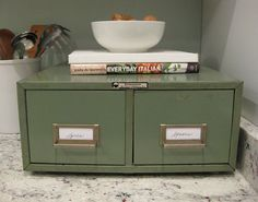 omg, where can I get a library card catalog drawer set?  They used it here as a spice rack, and I love that idea!