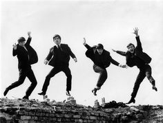 The Beatles jump during a photoshoot for their Twist & Shout EP cover. Fiona Adams / Redferns / Getty Images.