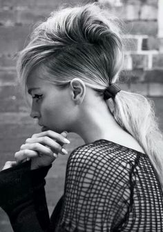 A ponytail with a very low side part has a very nouvelle vague look to it.