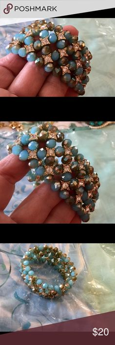 Stunning bracelet I believe this is a Premier Designs bracelet.  If I am wrong please correct me. Beautiful blue/tan stones with crystals.  This is a stretch bracelet. Premier Designs Jewelry Bracelets