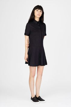 $95-100% Silk  The Eira dress features a soft collar and hidden pockets. This Black Silk Dress   is a must in the wardrobe.