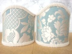 Couple of lampshades decorated with damask fabric with floreal patterns in high relief, finished with Ivory trimmings. 34,00 €