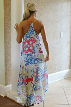 This negative print floral maxi dress is colorful and beautiful! It features adjustable straps and a scooped hemline.