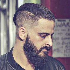 Slicked Back Hair with High Fade and Thick Beard