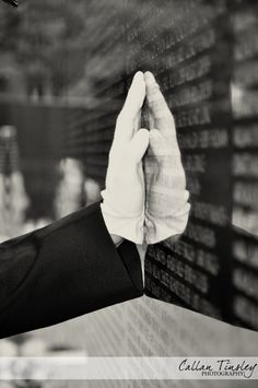 A U.S. Marine at the Vietnam wall. ((www.callantinsley.com))