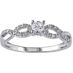 1/10 CT. T.W. Diamond & Lab-Created White Sapphire Engagement Ring ($110) ❤ liked on Polyvore featuring jewelry, rings, accessories, wedding rings, bijoux, diamond jewelry, round diamond ring, wedding band rings and white sapphire wedding rings
