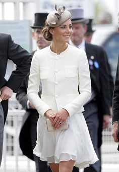 Kate attended Derby Day, everyone dressed to the nines. The Duchess was in a whiteReiss dress and beige fascinator. via StyleList