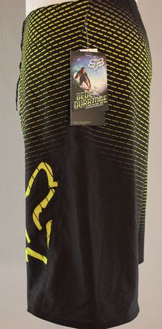 Fox Racing Bede Durbidge signature black & yellow boardshorts.  Great for surfing or swimming!