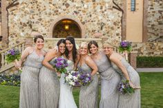 I like the idea for silver sparkle bridesmaid dresses with the purple bouquets.