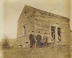"Fred, Jake and Ernest ""Mooney"" Warther standing in front of their birthplace on Dover Hill in Dover, Ohio. Mooney Warther is known for his beautiful and intricate carvings."