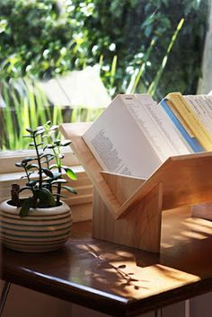 unique bookshelf idea; a short one would be great for cookbooks