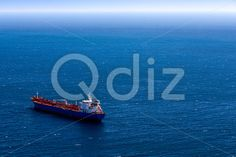 Qdiz Stock Photos | View from above to cargo ship,  #above #blue #boat #cargo #commerce #commercial #container #deep #delivery #freight #horizon #industrial #industry #international #logistics #marine #moving #nautical #ocean #open #sea #seascape #ship #shipping #sky #tanker #transport #transportation #vessel #view #water #waterline