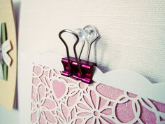 pin things up using paper clips and hanging them on thumbtacks