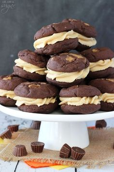 Reese's Peanut Butter Chocolate Cookie Sandwiches - moist and chewy chocolate cookies stuffed with mini Reese's, then filled with peanut butter cream cheese icing!