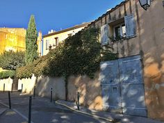 I loved how the afternoon shadows added to thedizzying perspective on this crooked street with leaning houses in Aix-en-Provence, France. We had a joyful