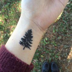my small pine tree tattoo