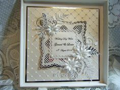 8 x 8 Wedding Day card - White on White with a touch of silver mirri and foiled sentiment as the center piece.  Sue Wilson embossing folder. Various spellbinder, tattered lace and Marianne dies used,