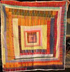 Folk art + quilting = Gees Bend housetop quilt.
