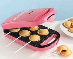 The Pie Pop Maker from Babycakes is a cute take on cake pops. The Babycakes Pie Pop Maker comes with recipes and a stainless steel crust cutter to make the perfect-sized pops. The Pie Pop Maker will make your dessert in just 4 minutes or less, but if you Cool Kitchen Gadgets, Cool Gadgets, Cool Kitchens, Baby Cakes, Cafe Restaurant, Popcake Maker, Cake Pops, Pink Pie, Cake Pop Maker