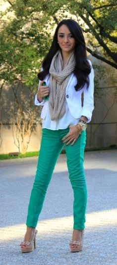 Cute turquoise jeans with a white top, beige scarf and gold accents