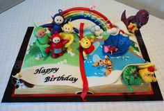 """""""Anekha's Book of Wonders"""" The family is celebrating the 1st birthday of their lovely daughter who is fascinated by Books, Teletubbies , Barney, Winnie the Pooh, dogs ,birds, flowers and loves water…..the cake was made to resemble a children's book with all her favorite characters in it……Happy Birthday Anekha"""
