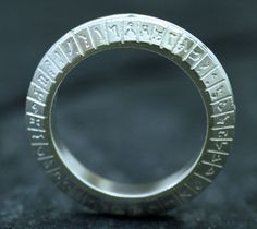 STARGATE SG-1 Inspired Sterling Silver Ring, Wedding Ring set with 9 Brilliant Diamonds Made To Order. $500.00, via Etsy.