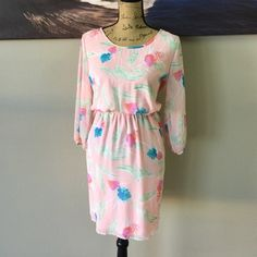 PEACH LOVE CALIFORNIA Dress Beautiful flowy dress! fun flower pattern with unique bow in back. elastic waist  100% polyester Peach Love California Dresses