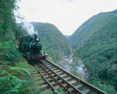 The West Coast Wilderness Railway, Tasmania is a reconstruction of the Mount Lyell Mining and Railway Company railway between Queenstown and Regatta Point. Train Tracks, Train Rides, Queenstown Tasmania, Tasmania Hobart, Rio, Train Journey, Beautiful Places To Visit, Day Tours, Australia Travel