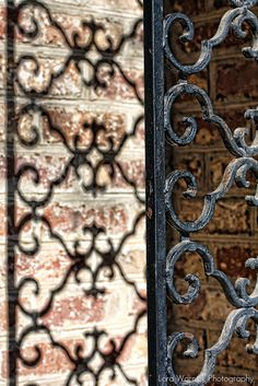 photo capturing not just the ironwork, but also its shadow