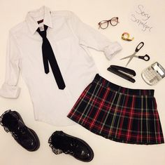 For this Sexy School Girl costume grab a white button down and pair it with a Tripp NYC pleated miniskirt and tie! Throw on some ruffle socks and creepers for a look that will break dress code... And hearts <3 http://www.trashandvaudeville.com/AF5007-BLK.html http://www.trashandvaudeville.com/HF6052-BLKPLD.html