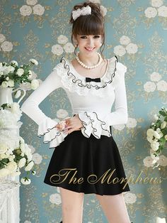 Morpheus Boutique  - White Ruffle Long Sleeve Princess Shoulder Layer Trendy Shirt Top, $49.99 (http://www.morpheusboutique.com/products/copy-of-grey-ruffle-long-sleeve-princess-shoulder-trendy-shirt.html)