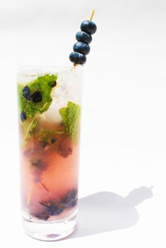 Blueberry & Vanilla Bean Mojito:    15 fresh blueberries  2 ounces white rum   1 ounce Vanilla Bean Simple Syrup  1 ounce freshly squeezed lime juice  10 mint leaves  Club soda    Website tells you how to make vanilla bean simple syrup