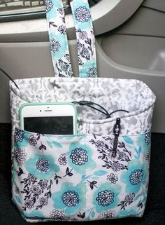 Keep everything you need handy - and organized - in the car with this sweet little bag! Mine holds my phone (and the cords, lol), a couple pens, and anything else I want to toss in there quick while I'm driving. From the front you can see it has all the f