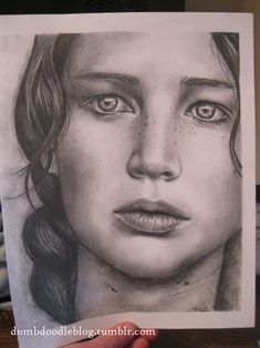 this is some amazing Katniss fanart. great job to whoever drew it :) i think i'll try and make something like it :)