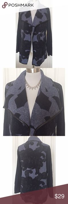 Chico's faux leather trim, open front sweater coat This sweater coat would be so cute with jeans or leggings. It is very soft and comfortable and is bordered by a black, faux, leather trim. Sz 2 in Chico's sizes is equivalent to large or sz 12. Chico's Sweaters