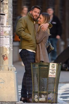 margot robbie and tom ackerley cuddle up to each other during an outing in new york