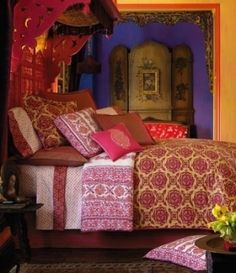 Purple and Gold walls....with colorful bedding for the guest room! Everything is OVER THE TOP when going Gypsy!