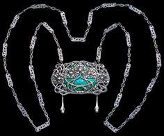 OMAR RAMSDEN 1873-1939 &  ALWYN CARR 1872-1940 Arts & Crafts Amorphic Jewel   Pendant: H: 7 cm (2.76 in)  W: 7.4 cm (2.91 in)  Chain: L: 114 cm (44.88 in)  British, c.1910 Large oval Art Nouveau Pendant