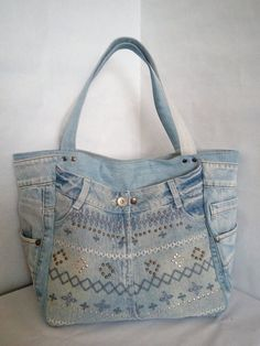 Bag of distressed jeans. Womens bag of jeans. A stylish bag of recycled jeans. Old jeans. Inside the bag lining with pockets. A bag for shopping and traveling. Size The length of the shoulder straps Bag with magnetic Jean Purses, Purses And Bags, Denim Bag, Denim Jeans, Denim Handbags, Summer Handbags, Denim Outfits, Weekender, Market Bag