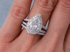 This is our gorgeous 2.95 ctw Pear Shape Diamond Engagement Ring and Matching Wedding Band Set. It has a sparkly 2.02 ct Pear Shape G color/SI2 clarity, Clarity Enhanced (Fracture Filled and Laser Drilled) Center Diamond. Set in a fabulous custom designed double shank band, 14K white gold setting, this set is listed for just $8,990!