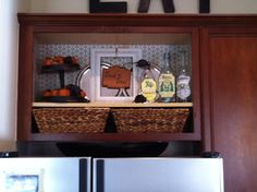 open cabinet above fridge