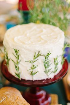 A simple white cake with rosemary adornments   Photography: Brian Leahy Photography - brianleahyphoto.com/  Read More: http://www.stylemepretty.com/living/2014/09/15/late-summer-harvest-picnic/