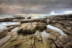 Rocks and waves at sunrise
