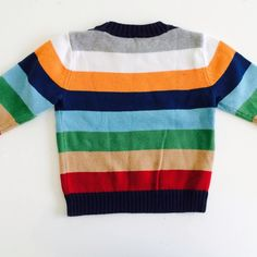Cotton sweater in colorful stripes. Excellent condition with some color fading caused by wash and wear. Size 3T.