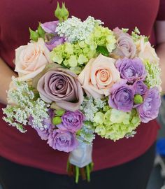 Soft and romantic bridal bouquet or roses, and hyrdrangea