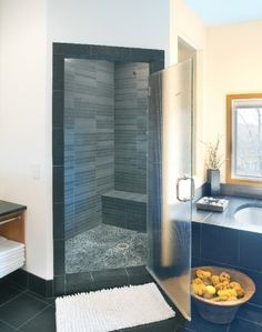 Rectified slate walls and riverstone floor tile were used in this contemporary shower.