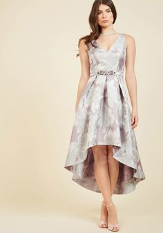 <p>Impress everyone at the gala with your splendor by making an entrance in this muted lavender gown from Eliza J.! Crafted beautifully with a V-neckline, stunning silver-threaded floral print, and dramatic high-low hem - and made extra-special with a bejeweled belt - this pocketed beauty earns admiring looks from all over.</p>