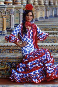 photo ...  woman wearing a dress typical of  traditional Sevillanas  ...  Espana  ... styles vary over the years ... the number and size of the ruffles on the skirt ... sleeves  ... colors ...