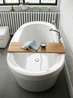 Deep bathtub, light, book. Even includes the glass of wine (in a stemless glass, so it's less likely to spill).