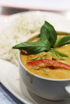 Panang Curry  Coconut milk, panang curry, peanut butter, chicken, bell peppers, kaffir lime leaves, and basil.